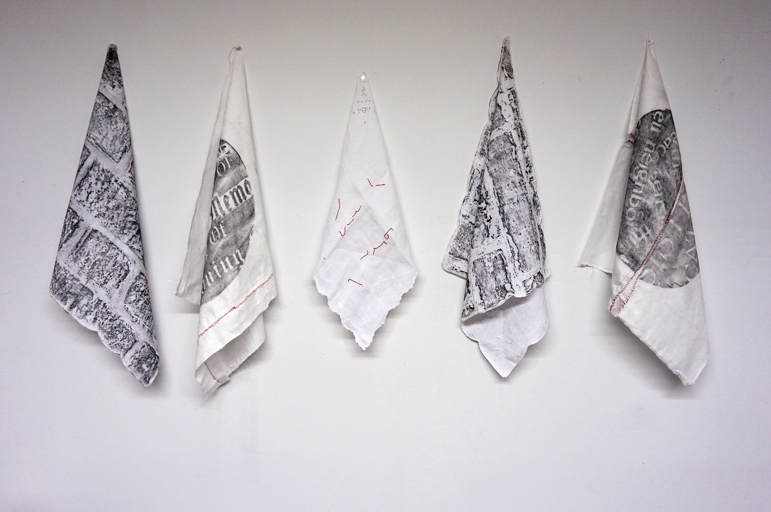 Sketches and rubbings on white linen